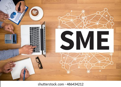 SME or Small and medium-sized enterprises Business team hands at work with financial reports and a laptop