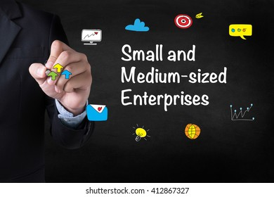 SME or Small and medium-sized enterprises Businessman drawing Landing Page on blurred abstract background