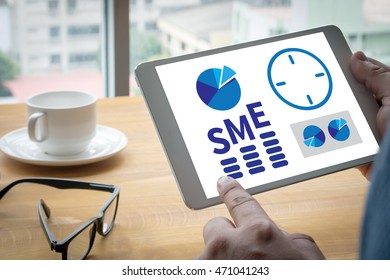 SME or Small and medium-sized enterprises Computing Computer  Laptop with screen on table Silhouette and filter sun