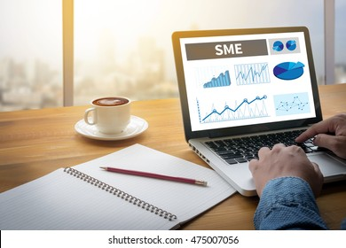 SME or Small and medium-sized enterprises Computing Computer  flare sun, Cropped image male freelancer sitting at the table