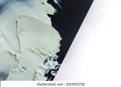 Smear clay mask for face and body. texture is smeared isolated on a black background. natural products smear paint of mud cosmetic from clay care