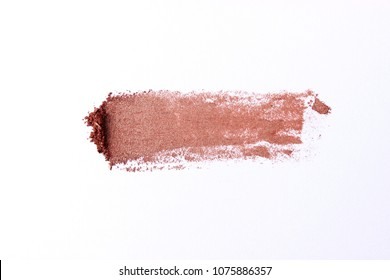 A smear of colored cosmetic eye shadow on a white background. a palette of shadows. women's cosmetics. minimalism, procurement for design. top