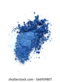 Smear of crushed blue eyeshadow as sample of cosmetics product  isolated on white