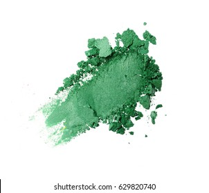 Smear of crushed green eyeshadow as sample of cosmetic product isolated on white background
