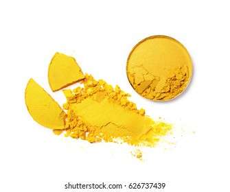 Smear of crushed yellow eyeshadow as sample of cosmetic product isolated on white background