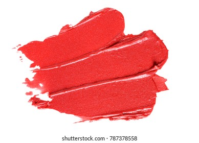 Smear paint of red lipstick cosmetic product isolated on white background. Macro shot