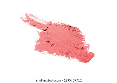 Smear and texture of lipstick or acrylic paint isolated on white background. Stroke of lipgloss or liquid nail polish swatch smudge sample. Element for beauty cosmetic design. Red color
