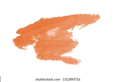 Smear and texture of lipstick or acrylic paint isolated on white background. Stroke of lipgloss or liquid nail polish swatch smudge sample. Element for beauty cosmetic design. Orange color