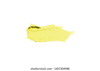Smear and texture of lipstick or acrylic paint isolated on white background. Stroke of lipgloss or liquid nail polish swatch smudge sample. Element for beauty cosmetic design. Yellow color