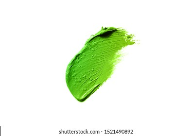Smear and texture of lipstick or acrylic paint isolated on white background. Stroke of lipgloss or liquid nail polish swatch smudge sample. Element for beauty cosmetic design. Green yellow color