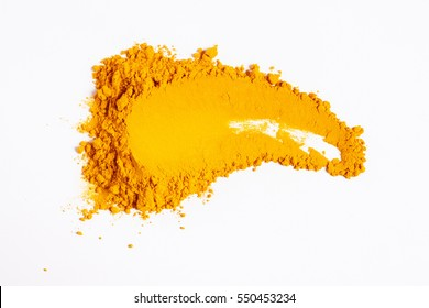 Smear of turmeric. Isolated on white. Up view.