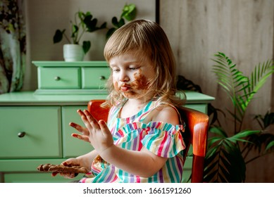 Smeared baby eating chocolate for the first time.Chocolate Day July 7th.