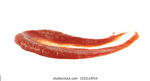 Smeared puddle of ketchup isolated over the white background
