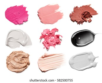 Smears of different colors are made with various cosmetic products isolated on a white background. Texture of multi-colored strokes of various make-up cosmetics on a white background