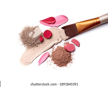 Smears of foundation for face. Pink red lipstick smeared on white background. Loose Eye Shadow. Cosmetic products. Beauty and makeup concept