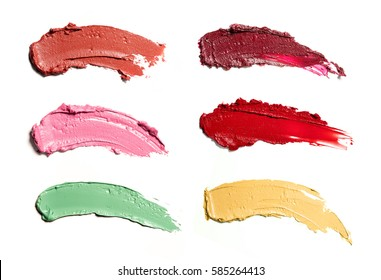 Smears of lipstick in different colors isolated on white background.