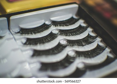 Smederevo, Serbia - JAN 25, 2017 Makeup for women. Artificial eyelashes. Upgrading. Manicurist master makes longer eyelash with this package.