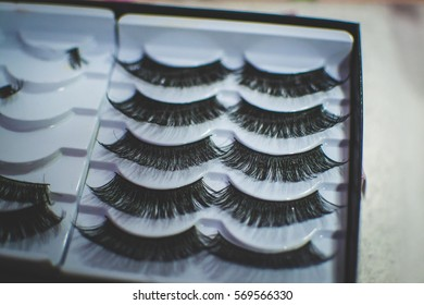 Smederevo, Serbia - JAN 25, 2017 Makeup for vomen. Artificial eyelashes. Upgrading. Manicurist master makes longer eyelash with this package.