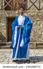 Smederevo, Serbia - May 02, 2019: The Smederevo Fortress is a medieval fortified city in Smederevo, Serbia. Medieval nobleman from China with clothes from the 14th century. Traditional chinese costume