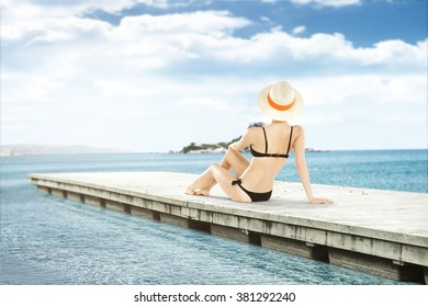 smell of summer and woman on top of pier and sea
