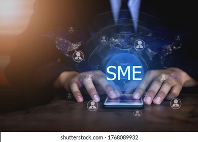 SME,SMEs (or small and medium enterprises), along with personal network icons and hand-held shopping. Element of this image furnished by Nasa
