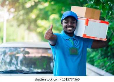 Smile african postal delivery courier man in front of car delivering package