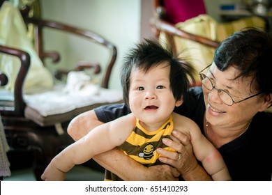 Smile Asian Baby with his grandma