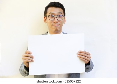 smile Asian business man wears glasses and holds white cardboard paper with white background