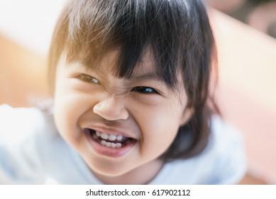 The smile of Asian children in summer