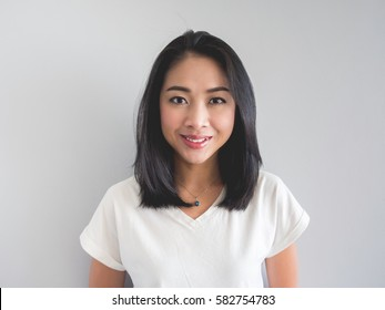 Smile Asian woman straight face portrait in white t-shirt.
