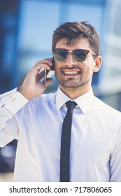 The smile businessman in sunglasses phone