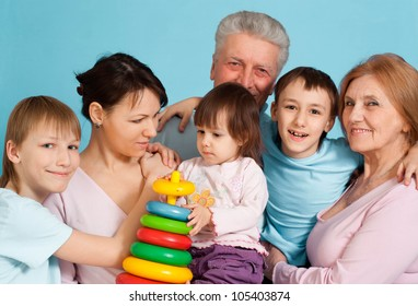 Smile Caucasian happy family standing on a blue background