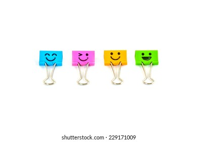 Smile colorful binder clips isolated on white
