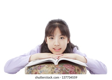 A smile and cute Asian girl seriously learning