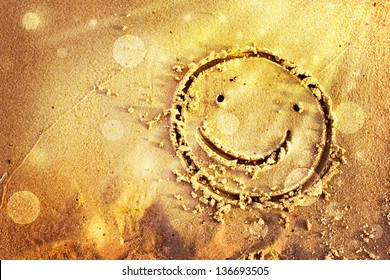 Smile drawn in the sand/Summer background with a sand