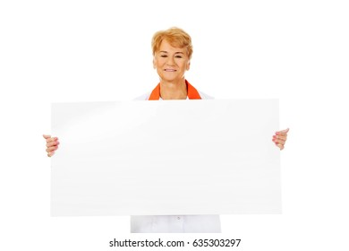 Smile elderly female doctor or nurse holding blank banner