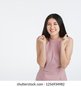 Smile face of beautiful black long hair young Asian woman in pink dress. Girl pose in feeling very happy amazed excited and surprised, studio light portrait shot isolated on white background.