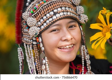 smile face close up young beautiful hill tribe girl with sunflower