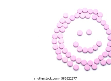 Smile face of pink pills  on white background. Tablets of drug for asthma treatment.