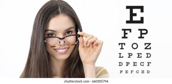 smile female face with spectacles on eyesight test chart background, eye examination ophthalmology concept