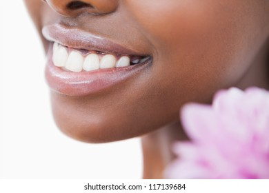 Smile and flower against white background
