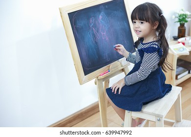 Smile girl draw cartoon with chalk and blackboard, kid, study, school, student and study concept.