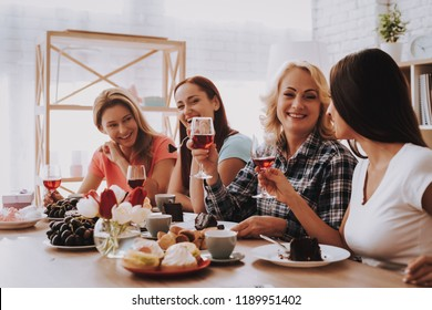 Smile Girl Drinking Wine and Eat Cake. Woman Speak with Family. People Speak with Family. Holiday and Happy Day 8 March. Smile Time with Happy Girl. People Drinking Wine and Eat Cake on Breakfast.