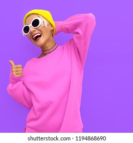Smile girl in fashion accessories. Beanie Cap, Sunglasses and choker. Colorful trendy urban vibes