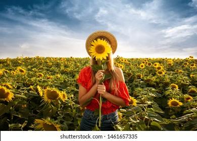 smile girl in field sunflower