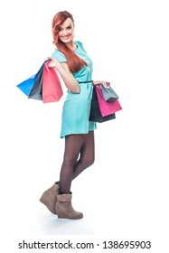 Smile girl with shopping bags, isolated on white background. Full length - total figure