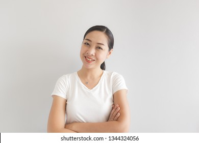 Smile and happy Asian woman in white t-shirt. Concept of happy and thinking positive.