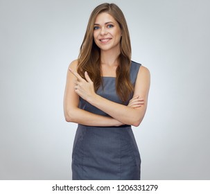Smile happy businesswoman pointing finger up. Isolated portrait on white.