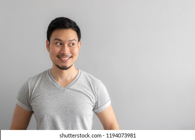 Smile and happy face of Asian man point to present an empty space of content. Advertising model concept.
