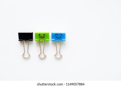 Smile and happy face paper clips.